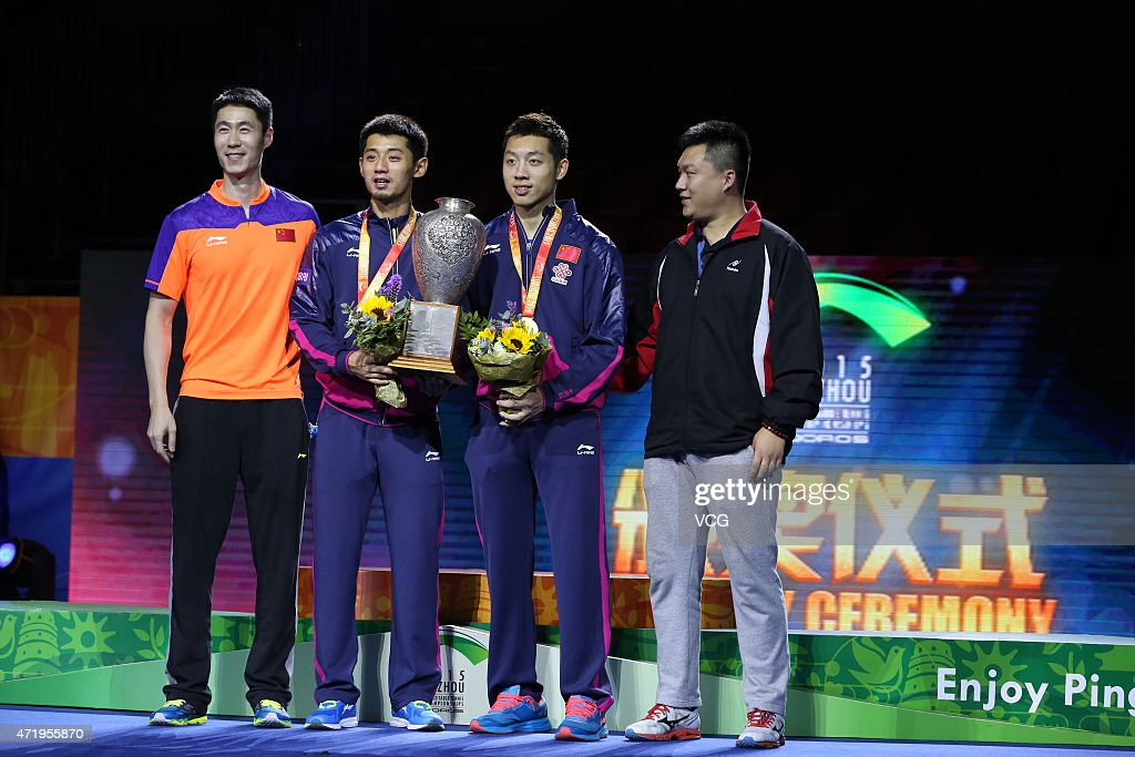 <a gi-track='captionPersonalityLinkClicked' href=/galleries/search?phrase=Zhang+Jike&family=editorial&specificpeople=4979400 ng-click='$event.stopPropagation()'>Zhang Jike</a> (L2) and Xu Xin (L3) of China stand on the podium after winning men's mixed doubles final match against Fan Zhendong and Zhou Yu of China on day seven of the 2015 World Table Tennis Championships at the Suzhou International Expo Center on May 2, 2015 in Suzhou, China.