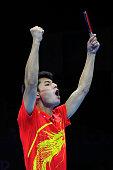 Zhang Jike celebrates defeating Seungmin Ryu and Sang Eun Oh of Korea 30 with playing partner Wang Hao of China and winning the Men's Team Table...