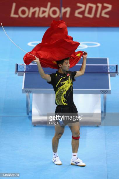 Zhang Jike of China celebrates victory after the Men's Singles Table Tennis Gold medal match against Wang Hao of China on Day 6 of the London 2012...
