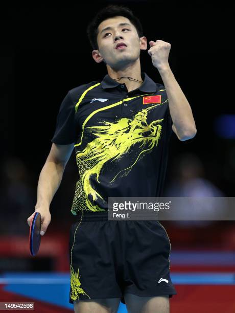 Zhang Jike of China celebrates winning his Men's Singles Table Tennis fourth round match against Vladimir Samsonov of Belarus on Day 3 of the London...