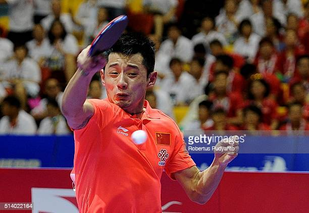 Zhang Jike of China competes against Yuya Oshima of Japan during the 2016 World Table Tennis Championship Men's Team Division final match at Malawati...