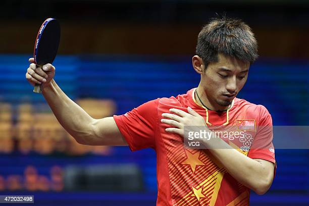 Zhang Jike of China reacts against Fang Bo of China during men's singles semifinal match on day eight of the 2015 World Table Tennis Championships at...
