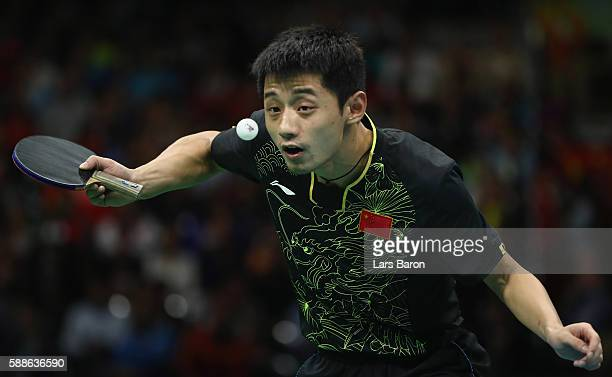 Zhang Jike of China serves during the Mens Table Tennis Gold Medal match between Ma Long of China and Zhang Jike of China at Rio Centro on August 11...