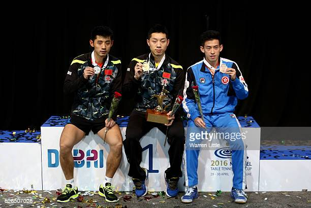 Zhang Jike of China Xu Xin of China and Wong Chun Ting of Hong Kong pose on the podium after the Men's singles final of the Nakheel Table Tennis...
