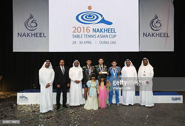 Zhang Jike of China Xu Xin of China and Wong Chun Ting of Hong Kong are awared their medals by Dawoud Al Hajri President of the UAE Badminton and...