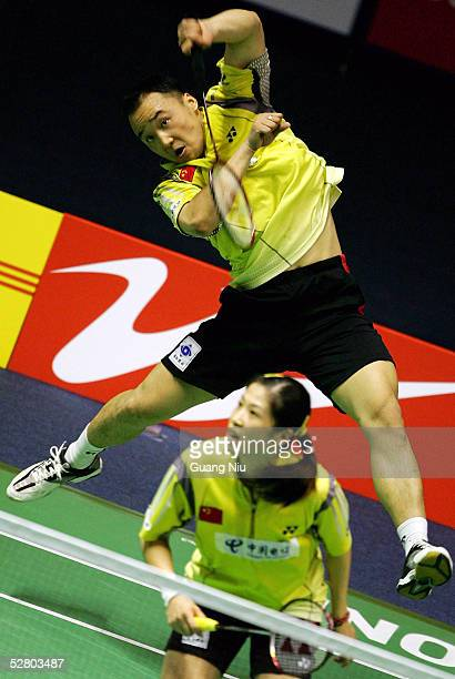 Zhang Jun and Gao Ling of China compete during the 2005 Sudirman Cup World Mixed Team Badminton Championships against Indonesia team at the capital...