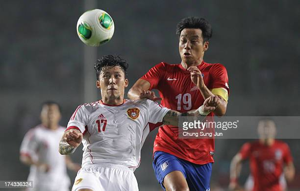 Zhang Linpeng of China competes for the ball with Yeon KiHun of South Korea during the EAFF East Asian Cup match between Korea Republic and China at...