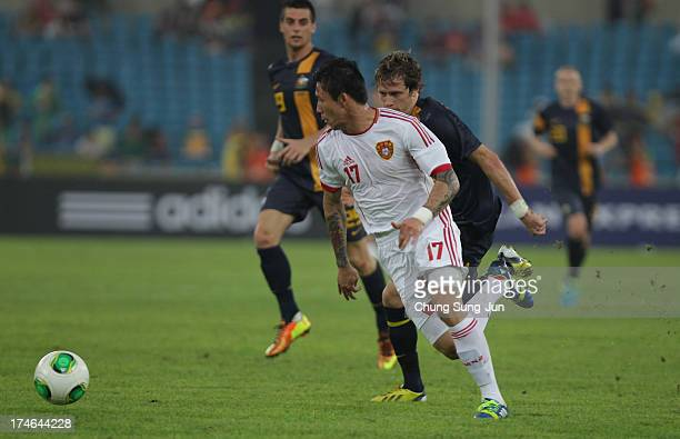 Zhang Linpeng of China in action during the EAFF East Asian Cup match between Australia and China at Jamsil Stadium on July 28 2013 in Seoul South...