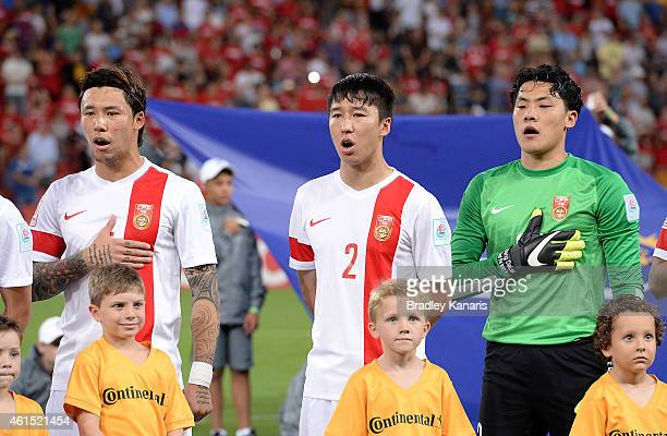 Zhang Linpeng Ren Hang and Wang Dalei of China sing the national anthem of China before the 2015 Asian Cup match between China PR and Uzbekistan at...