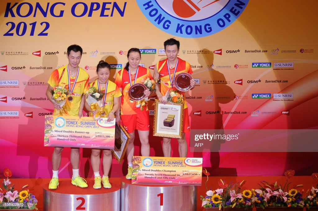 Zhang Nan (R) and Zhao Yunlei (2nd R) of China celebrate on the podium after beating their compatriots Xu Chen (L) and Ma Jin (2nd L) in the mixed doubles final at the Hong Kong Open badminton tournament on November 25, 2012. AFP PHOTO / Dale de la Rey