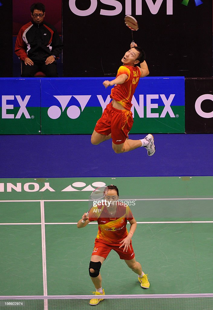 Zhang Nan (top) and Zhao Yunlei (bottom) of China compete against their compatriots Xu Chen and Ma Jin in the mixed doubles final at the Hong Kong Open badminton tournament on November 25, 2012. AFP PHOTO / Dale de la Rey