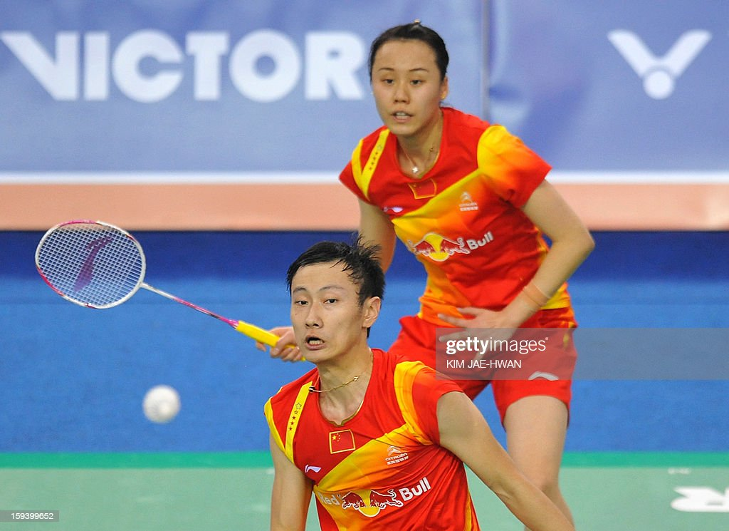 Zhang Nan (front) and Zhao Yunlei (back) of China play a shot in their mixed doubles badminton match against Ma Jin and Xu Chen of China during the finals of the Korea Open at Seoul on January 13, 2013. Yu Yang and Wang Xiaoli won the match 21-17, 21-13.