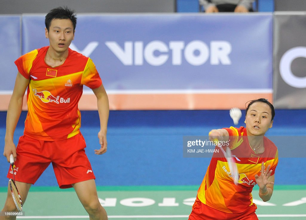 Zhang Nan (L) and Zhao Yunlei (R) of China play a shot in their mixed doubles badminton match against Ma Jin and Xu Chen of China during the finals of the Korea Open at Seoul on January 13, 2013. Yu Yang and Wang Xiaoli won the match 21-17, 21-13.