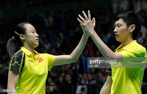 Zhang Nan and Zhao Yunlei of China reacts to a winning point against Shin BaekCheol and Lee HyoJung of South Korea during their mixed doubles final...