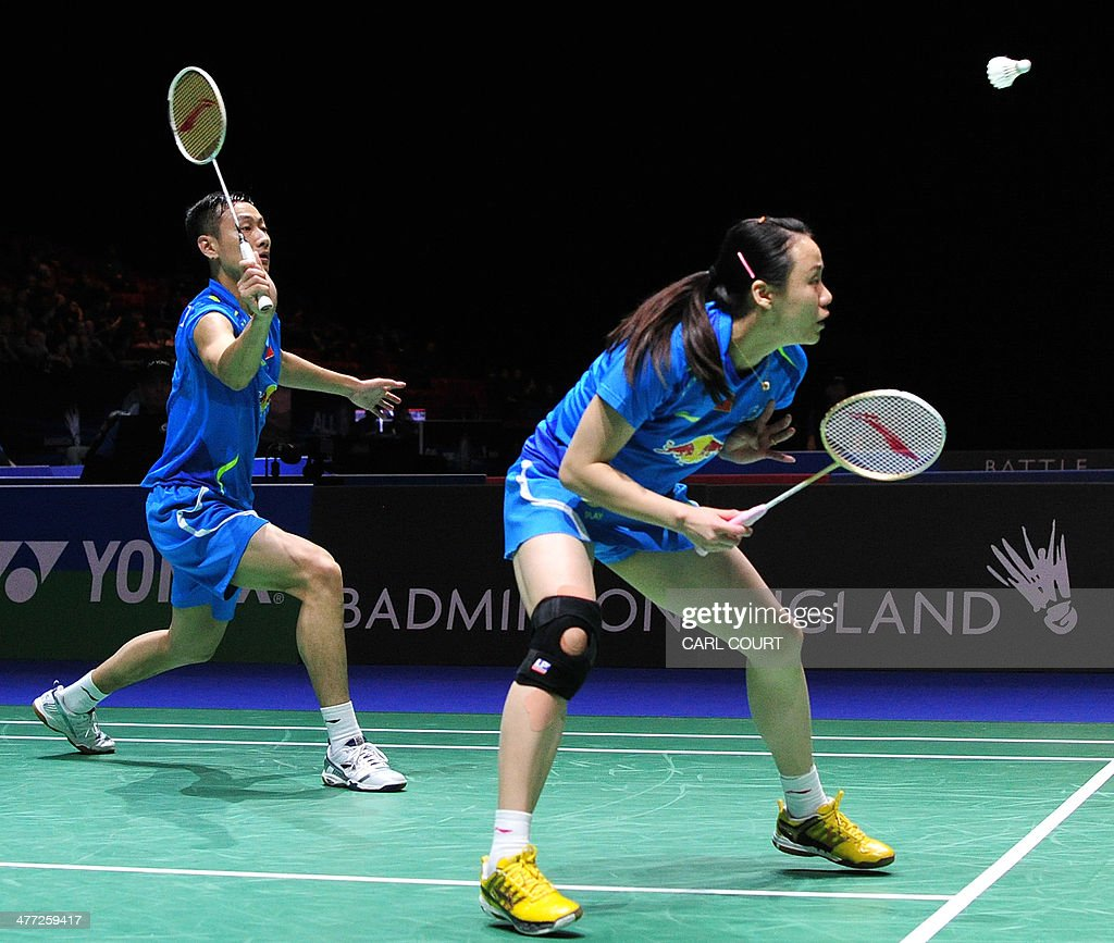 Zhang Nan L and Zhao Yunlei of China return against Ma Jin and