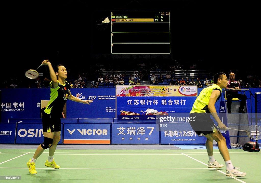 Zhang Nan and Zhao Yunlei (L) of China returns a shot against Yoo Yeon Seong and Eom Hye Won of South Korea during the mixed doubles final match of the 2013 China Masters in Changzhou, east China's Jiangsu province on September 15, 2013. Zhang and Zhao won 21-18, 21-12. CHINA