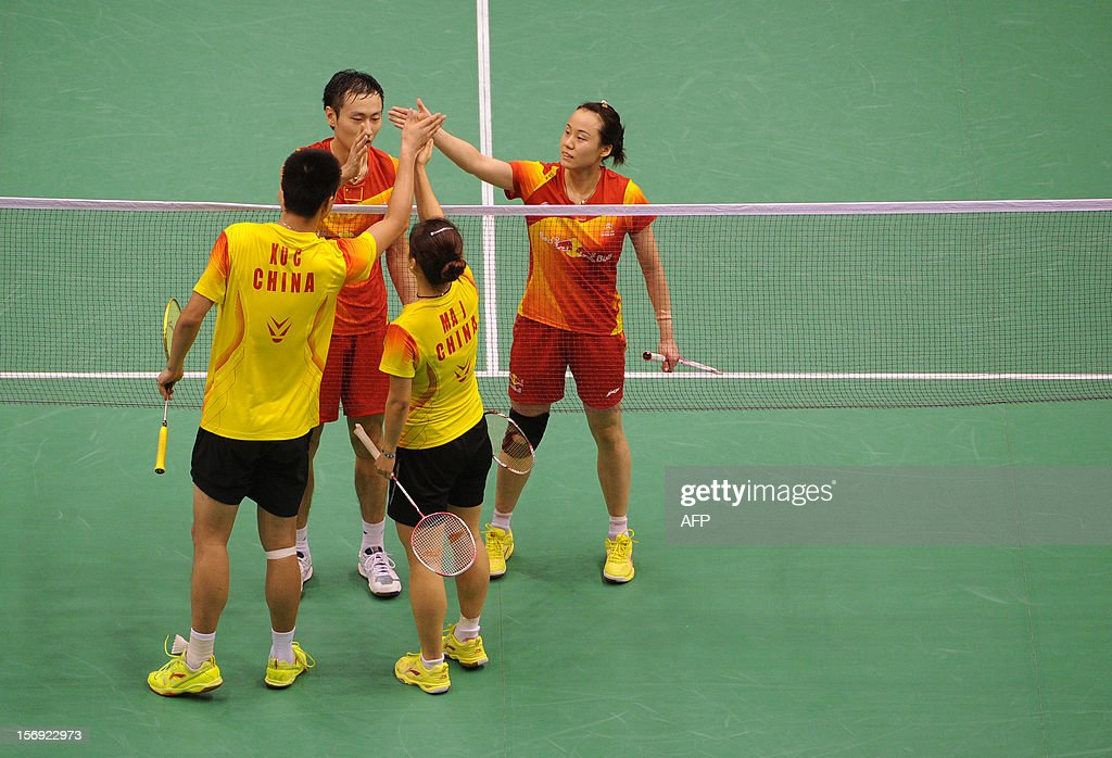 Zhang Nan (top L) and Zhao Yunlei (top R) of China shake hands with their compatriots Xu Chen ( lower L) and Ma Jin (lower R) after winning the mixed doubles final at the Hong Kong Open badminton tournament on November 25, 2012. AFP PHOTO / Dale de la Rey