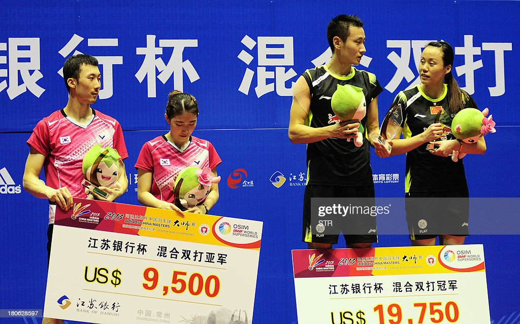 Zhang Nan and Zhao Yunlei (R) of China together with Yoo Yeon Seong (L) and Eom Hye Won of South Korea pose with their trophies during the award ceremony in the mixed doubles final match of the 2013 China Masters in Changzhou, east China's Jiangsu province on September 15, 2013. Zhang and Zhao won 21-18, 21-12. CHINA OUT AFP PHOTO