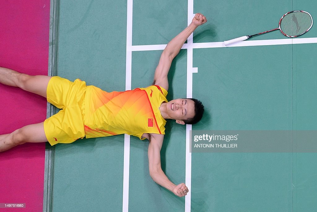 Zhang Nan of China falls to the court after victory in his mixed doubles final badminton match with Zhao Yunlei against compatriots Ma Jin and Xu Chen in London on August 3, 2012, for The 2012 London Olympic Games.