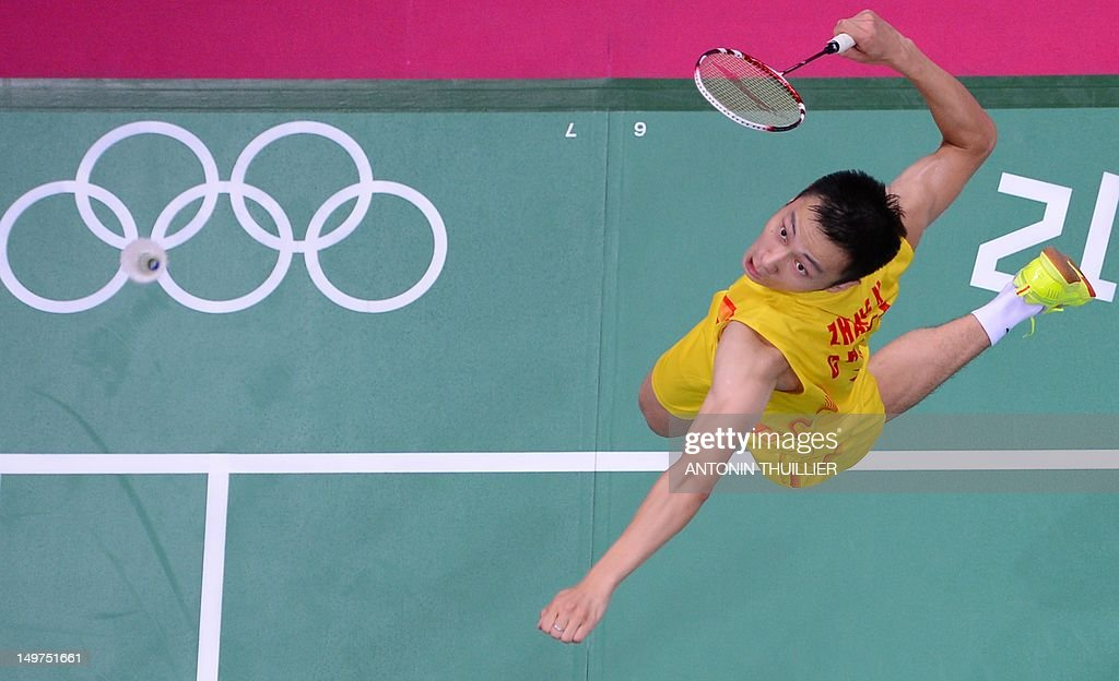 Zhang Nan of China prepares to play a smash during his mixed doubles final badminton match with Zhao Yunlei against compatriots Ma Jin and Xu Chen in London on August 3, 2012, for The 2012 London Olympic Games.