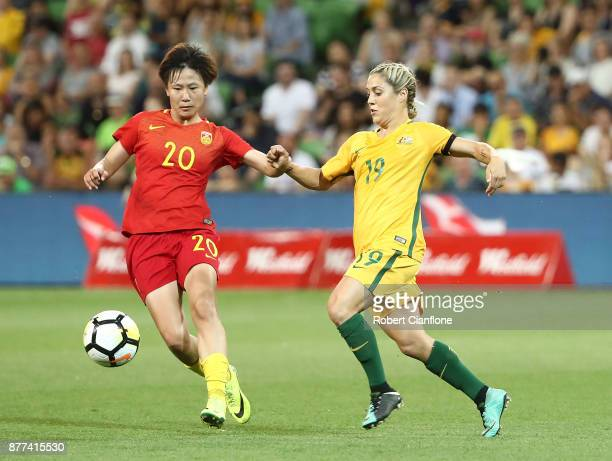 Zhang Rui of China PR is pressured by Katrina Gorry of the Matildas during the Women's International match between the Australian Matildas and China...