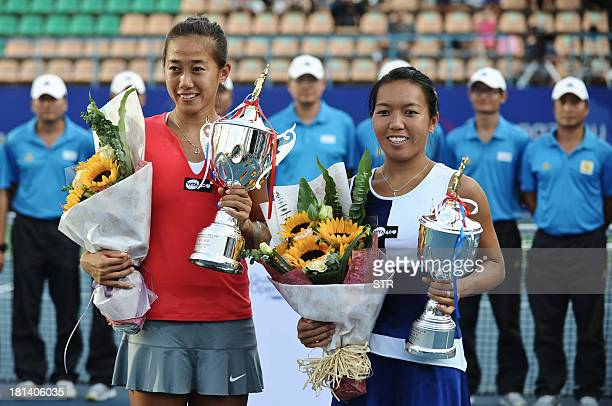 Zhang Shuai of China and Vania King of the US pose with their trophies during the awards ceremony for the Guangzhou Open tennis championship in...