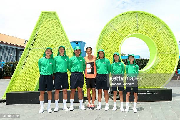 Zhang Shuai of China poses with Chinese representatives of the Australian Open 2017 ballkid squad during day two of the 2017 Australian Open at...