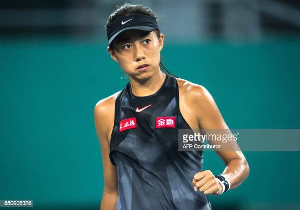 Zhang Shuai of China reacts after a point against Kateryna Kozlova of Ukraine during their women's singles quarterfinal match at the WTA Guangzhou...