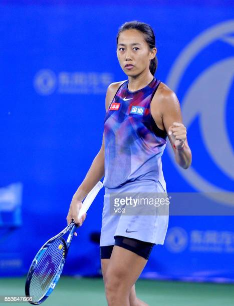 Zhang Shuai of China reacts during the first round match against Donna Vekic of Croatia on Day 2 of 2017 Dongfeng Motor Wuhan Open at Optics Valley...