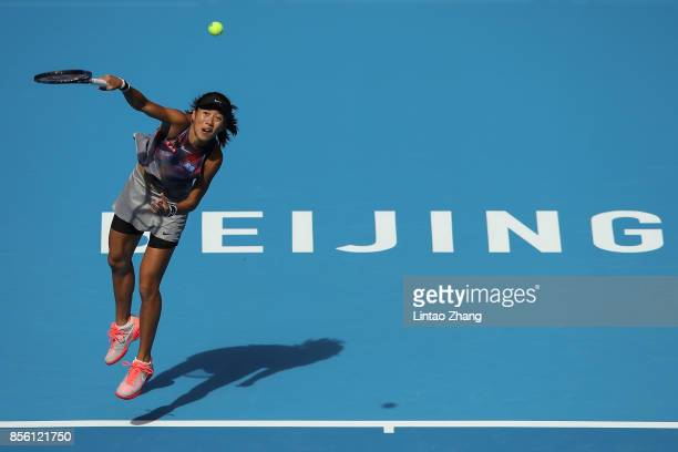 Zhang Shuai of China returns a shot against Yulia Putintseva of Kazakhstan during the Women's singles first round match on day two of the 2017 China...
