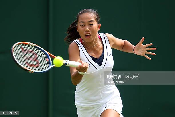 Zhang Shuai of China returns a shot during the first round match against Svetlana Kuznetsova of Russia on Day One of the Wimbledon Lawn Tennis...