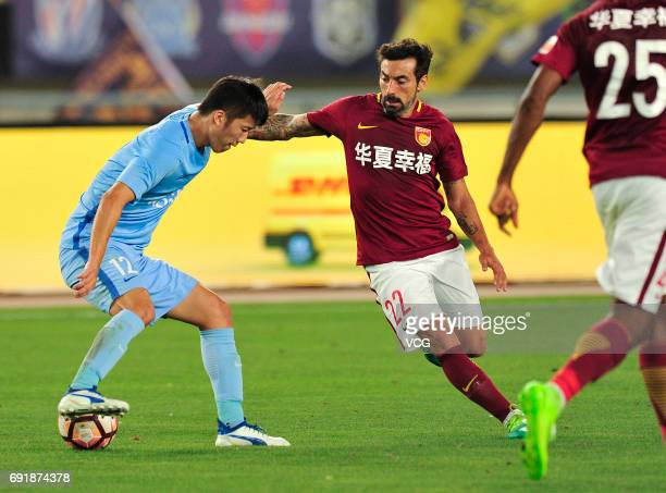 Zhang Xiaobin of Jiangsu Suning and Ezequiel Lavezzi of Hebei China Fortune FC compete for the ball during the 12th round match of 2017 Chinese...