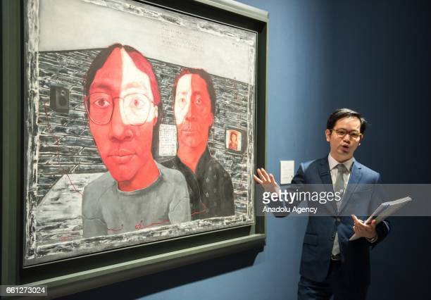 Zhang Xiaogang's Bloodline Mother and son No2 is being displayed during Sotheby's Hong Kong Spring sale preview at the Hong Kong Convention and...