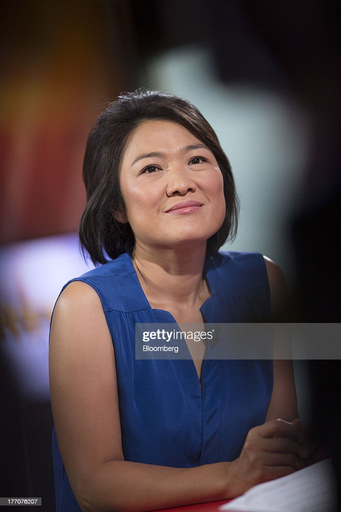 Zhang Xin, chief executive officer of Soho China Ltd., photographed from behind a television camera, pauses during a Bloomberg Television interview in Hong Kong, China, on Wednesday, Aug. 21, 2013. Soho China said yesterday underlying profit in the first half more than doubled with increased earnings from property sales. Photographer: Jerome Favre/Bloomberg via Getty Images