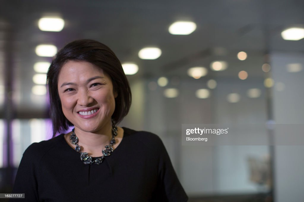 Zhang Xin, chief executive officer of Soho China Ltd., poses for a photograph in Hong Kong, China, on Thursday, March 7, 2013. Soho China, the biggest developer in Beijing's central business district, plans to accelerate land and project acquisitions this year as it shifts toward being a landlord from focusing on selling properties. Photographer: Jerome Favre/Bloomberg via Getty Images