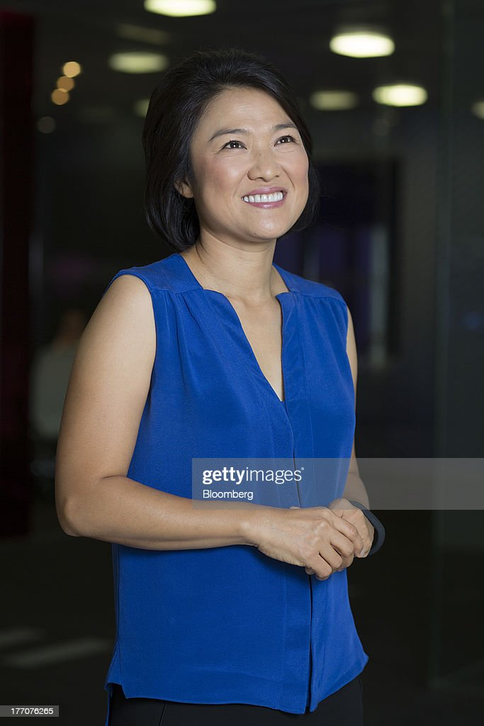 Zhang Xin, chief executive officer of Soho China Ltd., poses for a photograph in Hong Kong, China, on Wednesday, Aug. 21, 2013. Soho China said yesterday underlying profit in the first half more than doubled with increased earnings from property sales. Photographer: Jerome Favre/Bloomberg via Getty Images