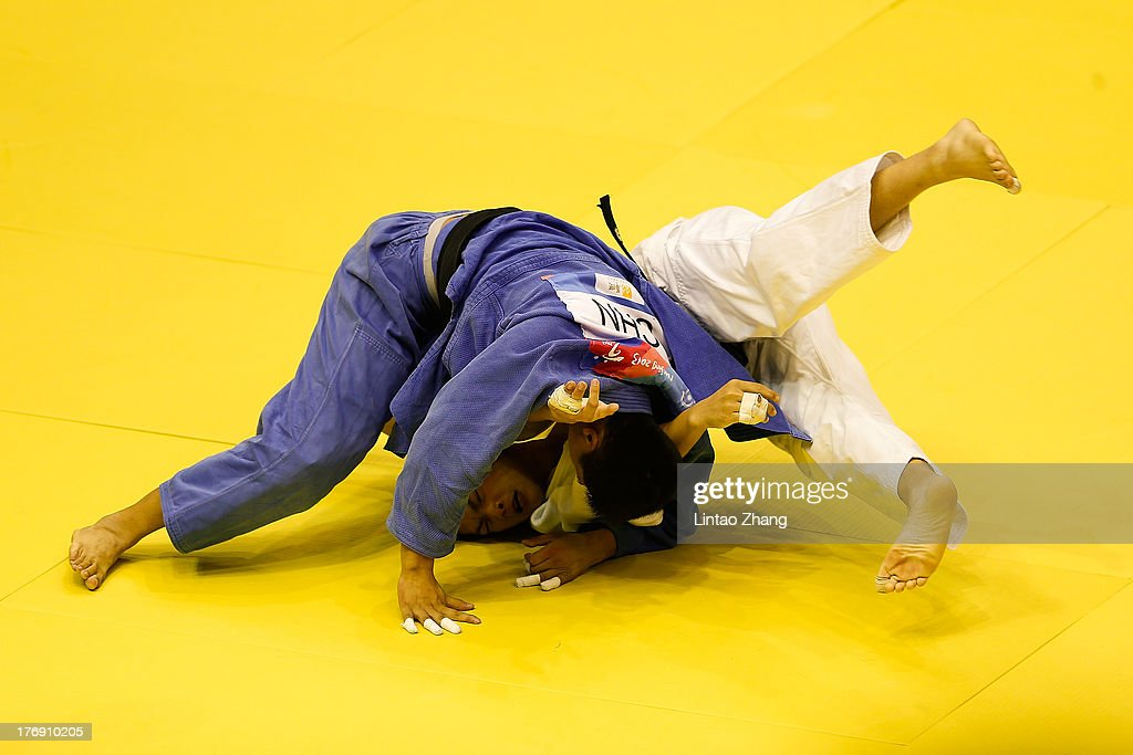 Zhang Xin (Blue) of China competes against Kai-lun Huang of China Taibei during the Men's 81Kg during day three of the 2nd Asian Youth Games on August 19, 2013 in Nanjing, China.