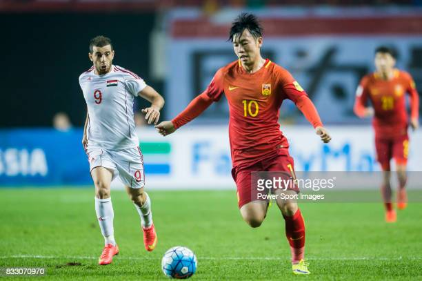Zhang Xizhe of China PR battles for the ball with Mahmoud Al Mawas of Syria during their 2018 FIFA World Cup Russia Final Qualification Round Group A...