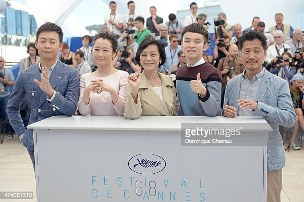 Zhang Yi Zhao Tao Sylvia Chang Dong Zijang and Liang Jingdong attend a photocall for 'Shan He Gu Ren' during the 68th annual Cannes Film Festival on...