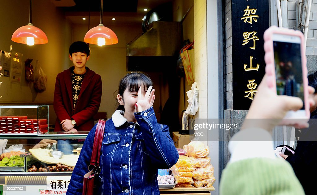 <a gi-track='captionPersonalityLinkClicked' href=/galleries/search?phrase=Zhang+Yu&family=editorial&specificpeople=559070 ng-click='$event.stopPropagation()'>Zhang Yu</a>, a boy who looks like South Korea actor So-hyun Kim attracts many girls to see at Lotus street on December 10, 2014 in Jinan, Shandong province of China. <a gi-track='captionPersonalityLinkClicked' href=/galleries/search?phrase=Zhang+Yu&family=editorial&specificpeople=559070 ng-click='$event.stopPropagation()'>Zhang Yu</a>, a boy who sold chestnuts at Lotus street of Jinan, east China's Shandong province was so similar to South Korea actor So-hyun Kim that he had attracted many girls to see.