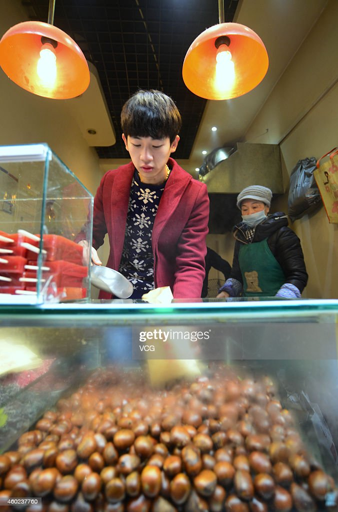 <a gi-track='captionPersonalityLinkClicked' href=/galleries/search?phrase=Zhang+Yu&family=editorial&specificpeople=559070 ng-click='$event.stopPropagation()'>Zhang Yu</a>, a boy who looks like South Korea actor So-hyun Kim sells chestnuts at Lotus street on December 10, 2014 in Jinan, Shandong province of China. <a gi-track='captionPersonalityLinkClicked' href=/galleries/search?phrase=Zhang+Yu&family=editorial&specificpeople=559070 ng-click='$event.stopPropagation()'>Zhang Yu</a>, a boy who sold chestnuts at Lotus street of Jinan, east China's Shandong province was so similar to South Korea actor So-hyun Kim that he had attracted many girls to see.
