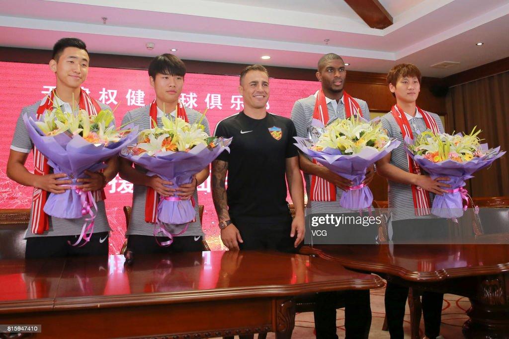 Zhang Yuan, Qian Yumiao, Tianjin Quanjian manager Fabio Cannavaro, Anthony Modeste and Pei Shuai pose at a press conference of Tianjin Quanjian FC on July 17, 2017 in Tianjin, China. Anthony Modeste plays for Tianjin Quanjian in the 2017 Chinese Super League (CSL) matches.