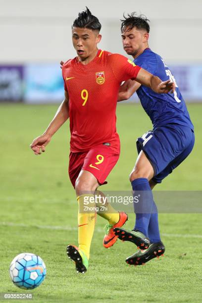 Zhang Yuning of China in action against Kevin Ingreso of Philippines during the CFA Team China International Football Match between China National...