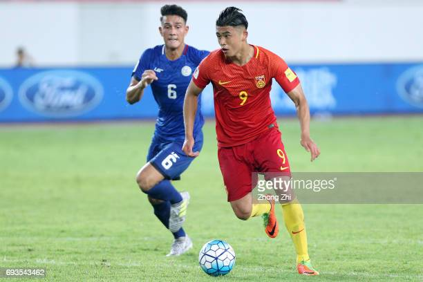 Zhang Yuning of China in action against Luke Woodland of Philippines during the CFA Team China International Football Match between China National...