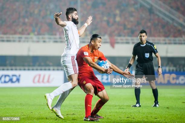 Zhang Yuning of China PR battles for the ball with Ahmad Al Saleh of Syria during their 2018 FIFA World Cup Russia Final Qualification Round Group A...