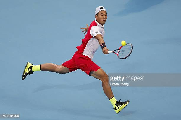 Zhang Ze of China returns a shot against Novak Djokovic of Serbia during the Men's singles second round match on day six of the 2015 China Open at...
