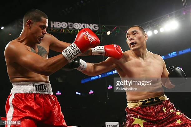 Zhang Zhilei and Glenn Thomas exchange punches during their heavyweight fight at the Barclays Center on June 6 2015 in the Brooklyn borough of New...