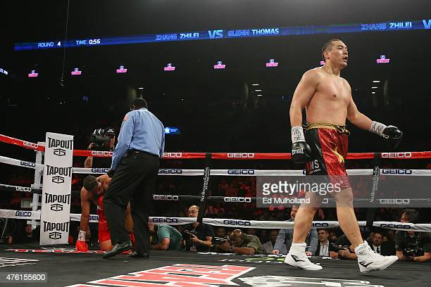 Zhang Zhilei knocks down Glenn Thomas during their heavyweight fight at the Barclays Center on June 6 2015 in the Brooklyn borough of New York City