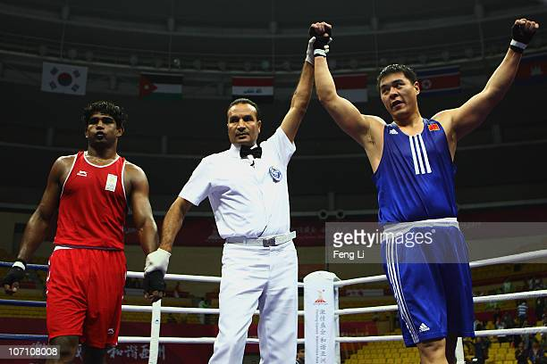 Zhang Zhilei of China celebrates winning against Paramjeet Samota of India in the Men's 91kg Semifinal at Foshan Gynasium during day twelve of the...