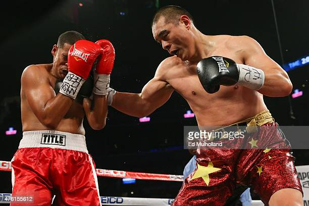 Zhang Zhilei punches Glenn Thomas during their heavyweight fight at the Barclays Center on June 6 2015 in the Brooklyn borough of New York City
